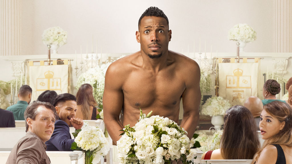 A naked Marlon Wayans covers himself with a bouquet of flowers in a crowded church