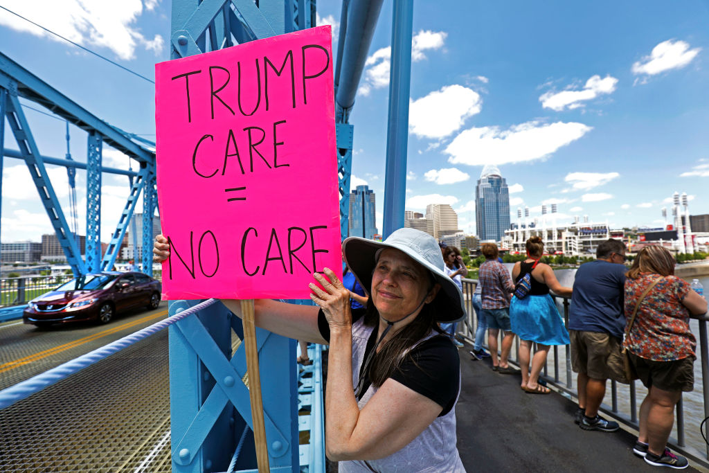 Protesters in Kentucky fight against the Affordable Care Act repeal, which would result in people losing health insurance coverage.