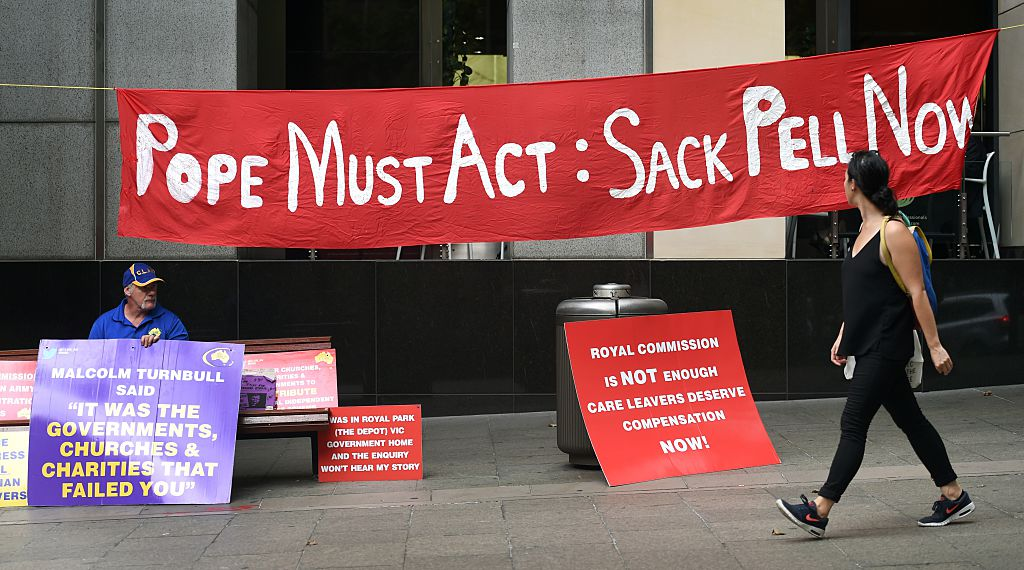 """sign that says """"pope must act: sack pell now"""""""
