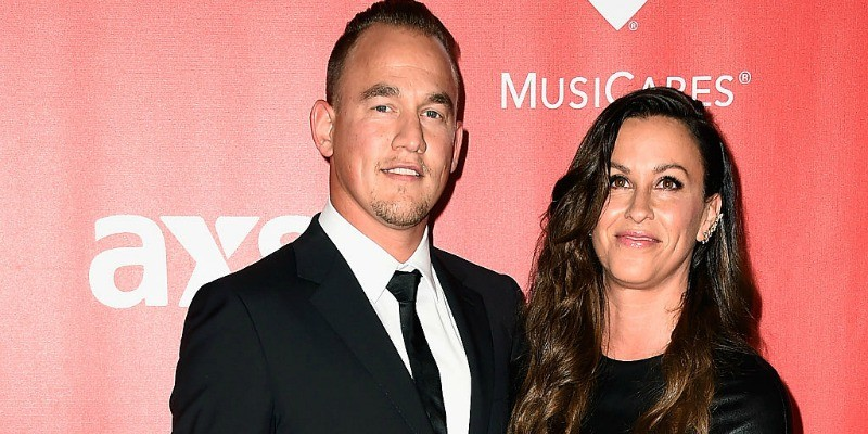 Alanis Morissette and Mario Treadway pose together on the red carpet.