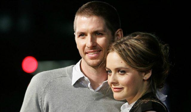 Alicia Silverstone and Christopher Jarecki pose together on the red carpet.