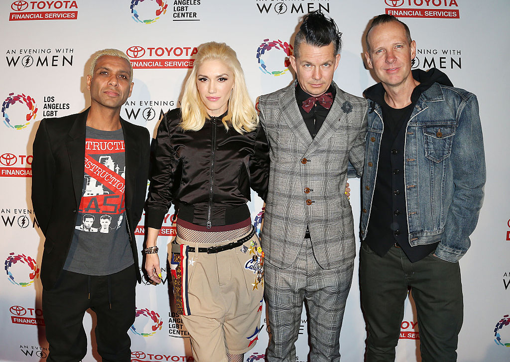 Gwen Stefani and No Doubt stand on the red carpet