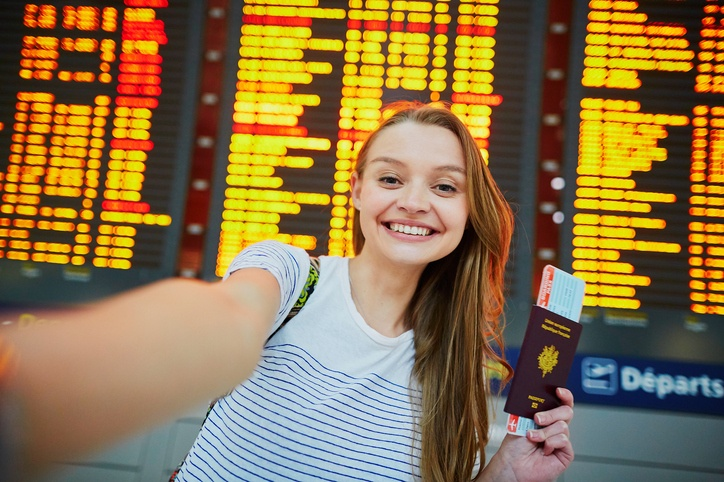 Beautiful young tourist girl in international airport