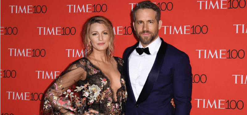 Blake Lively and Ryan Reynolds pose together on the red carpet.