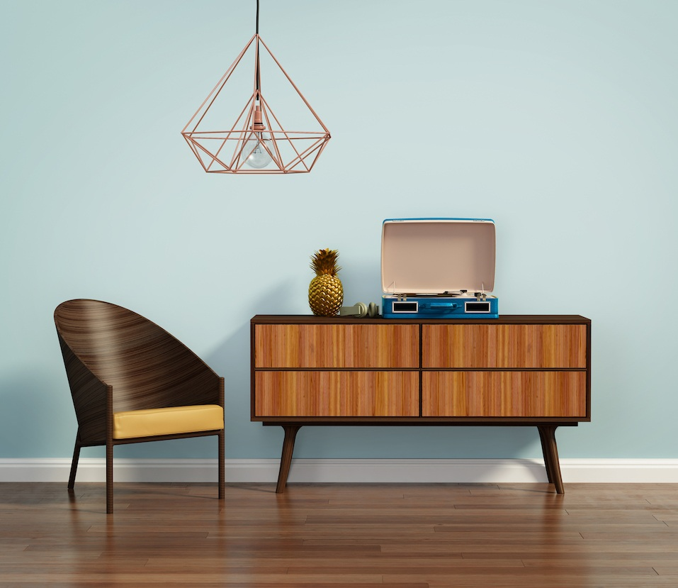 Blue interior with mid century chair and buffet