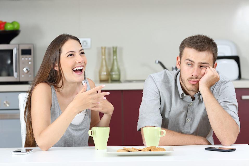 man looking bored at woman
