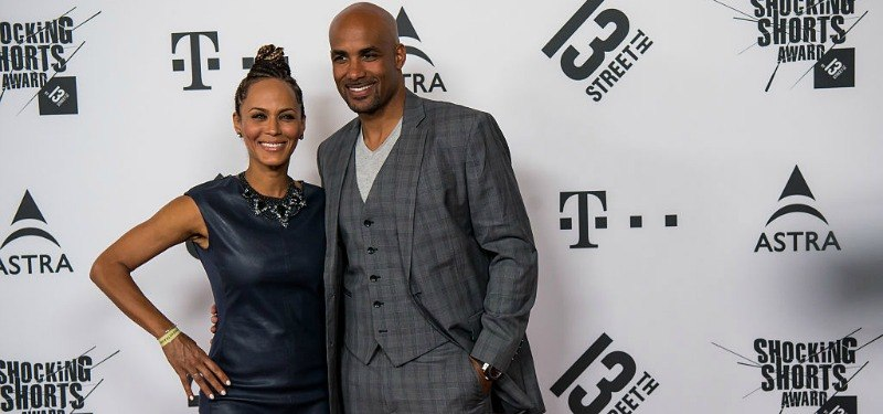 Boris Kodjoe and Nicole Ari Parker pose together on the red carpet.