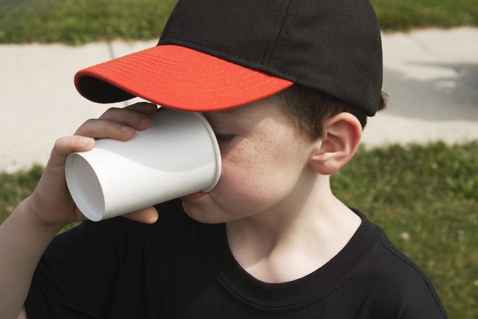 Boy Drinking From a Paper Cup