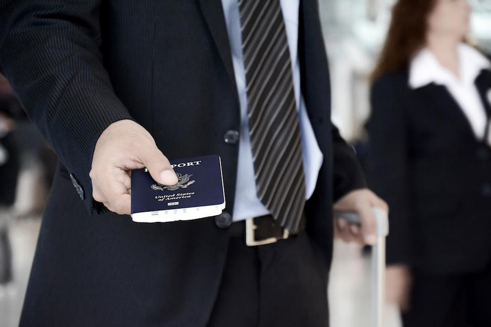 Businessman giving U.S. passport at the airport