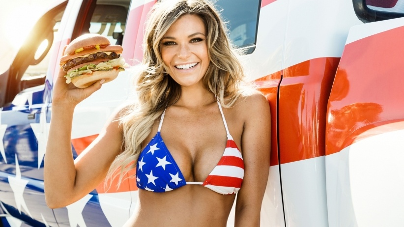 A Carl's Jr. ad depicts a woman with a burger and pickup truck -- advertising that is proving ineffective