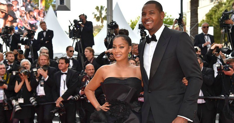 Carmelo and Lala Anthony are posing together on the red carpet.