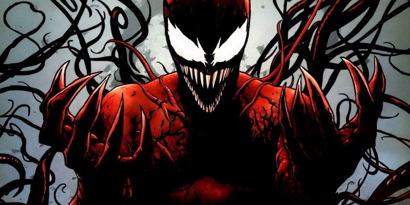 The villain Carnage holds up his hands in Marvel comics