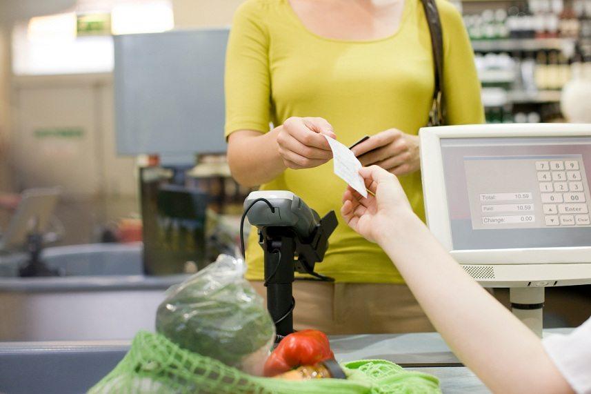 Cashier handing receipt