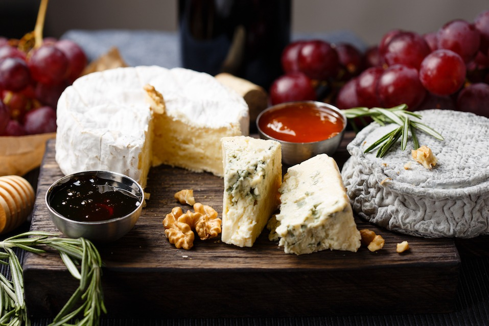 Cheese plate served with wine, jam and honey