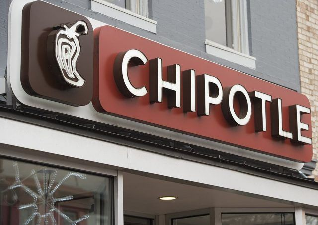 Front of Chipotle restaurant building, close-up of Chipotle sign and logo