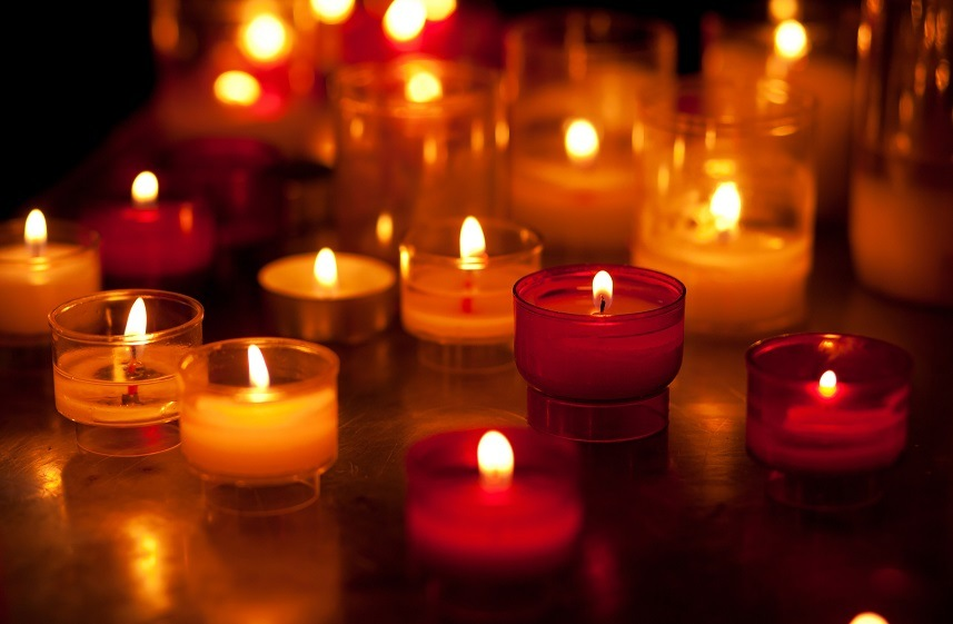 Church candles in red and yellow