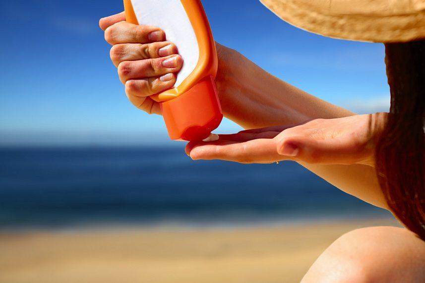 hand squeezing sun block