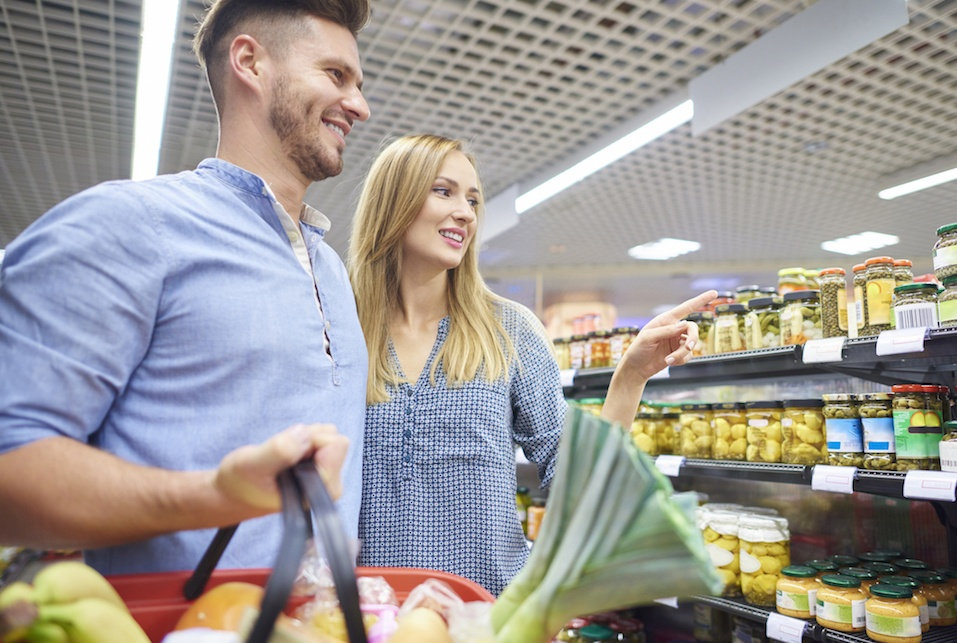 Couple shopping together in grocery store