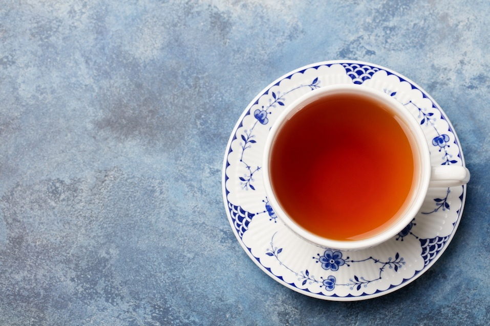 Cup of tea on a blue stone background