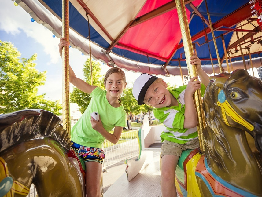 kids enjoying a ride on a fun carnival carousel