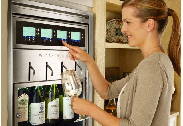woman getting wine from WineStation