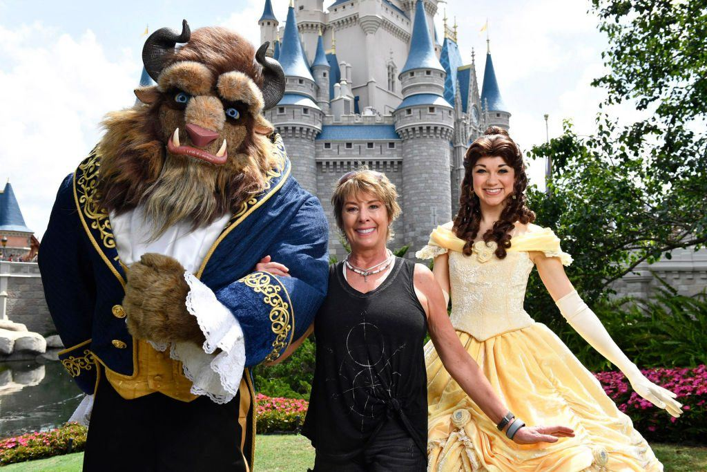 Woman with Beauty and the Beast at Disney World