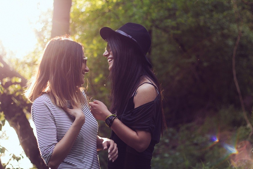 young girfriends giggling outdoor