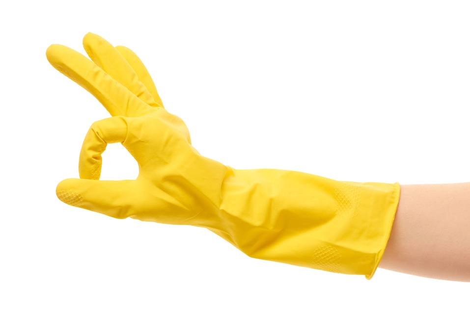 Female hand in yellow protective rubber glove