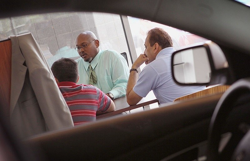 LINCOLNWOOD, IL - AUGUST 30: Wil Jordan (C), a salesman at the Grossinger Autoplex car dealership, speaks with customers on August 30, 2010 in Lincolnwood, Illinois. A strong demand for automobiles helped to drive consumer spending in July to its strongest pace in four months.