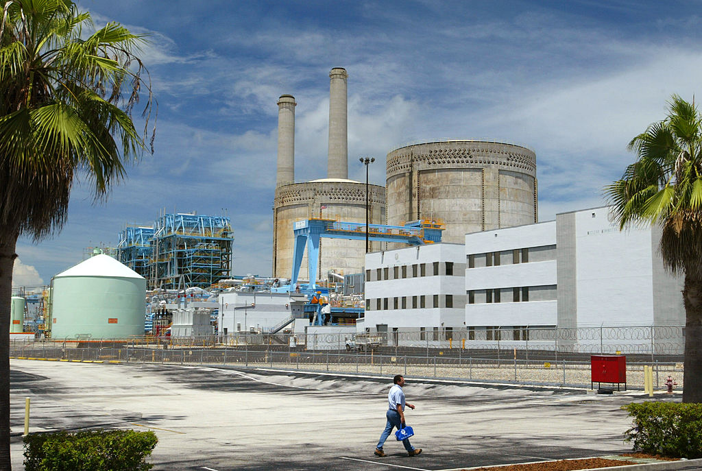 A worker walks by a Florida power plant
