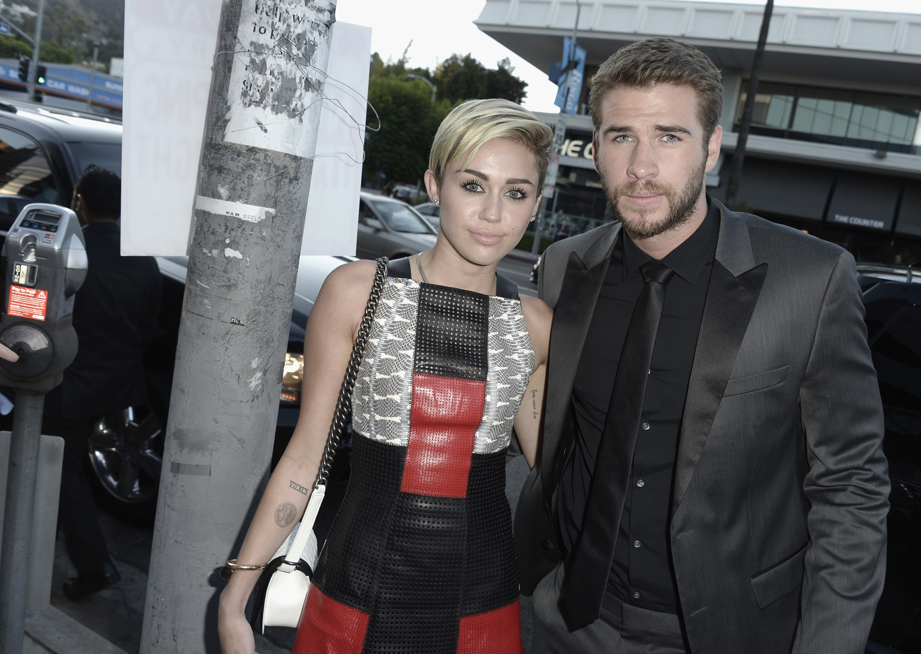 """Actress Miley Cyrus and actor Liam Hemsworth attend the premiere of Relativity Media's """"Paranoia"""" at the DGA Theater"""