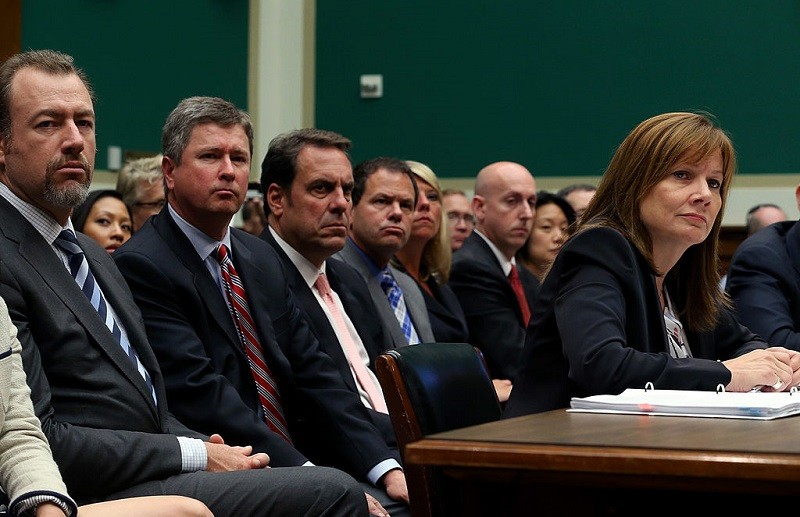 Mary Barra, CEO of General Motors, speak to Congress while GM executives look on in June 2014.