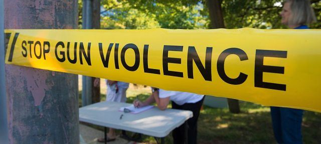 A yellow Gun Violence Prevention sign.