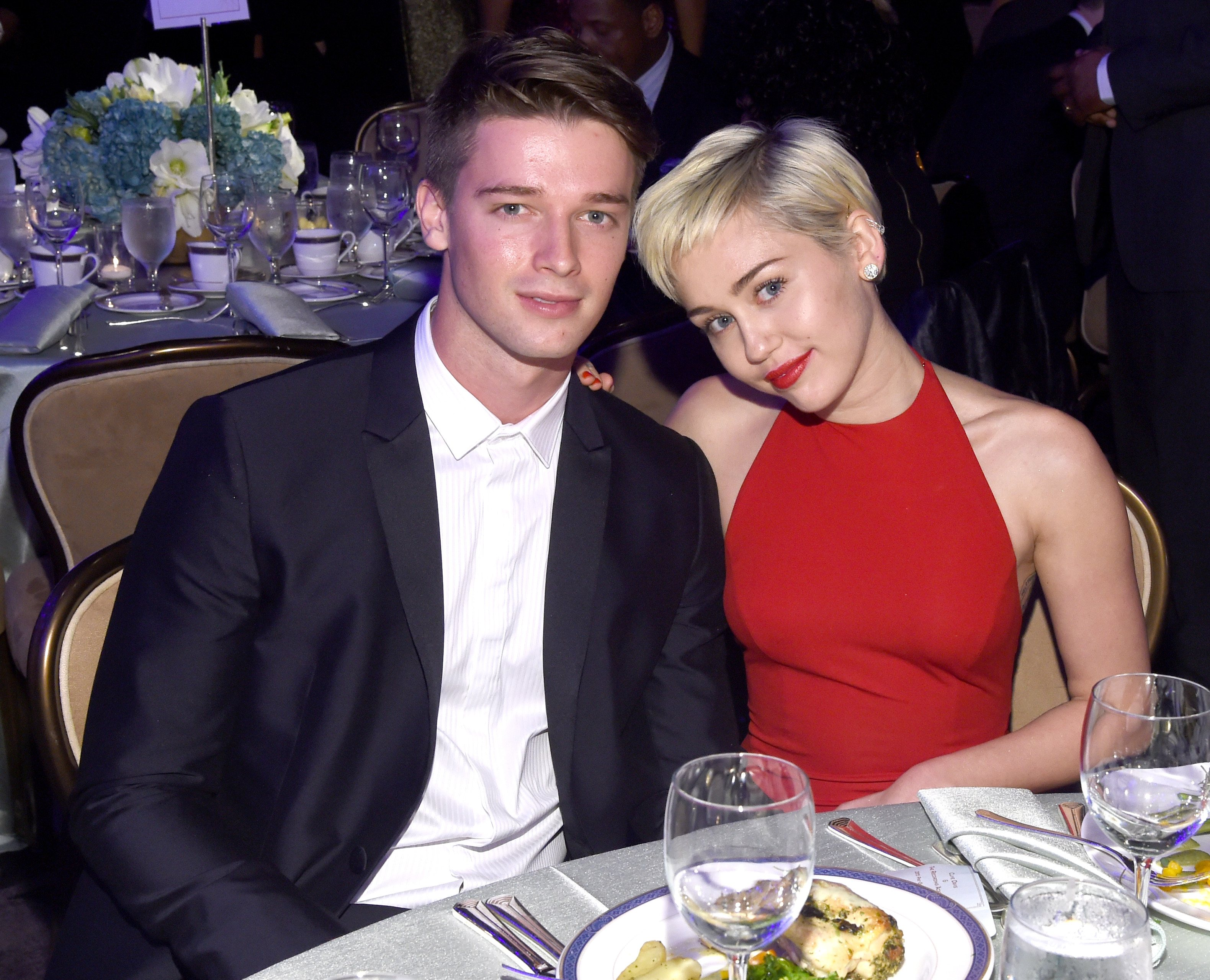 Miley Cyrus (R) and Patrick Schwarzenegger attend the Pre-GRAMMY Gala and Salute to Industry Icons