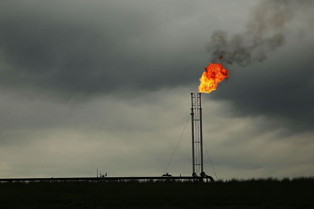 Natural gas is flared off at a plant outside of the town of Cuero, Texas