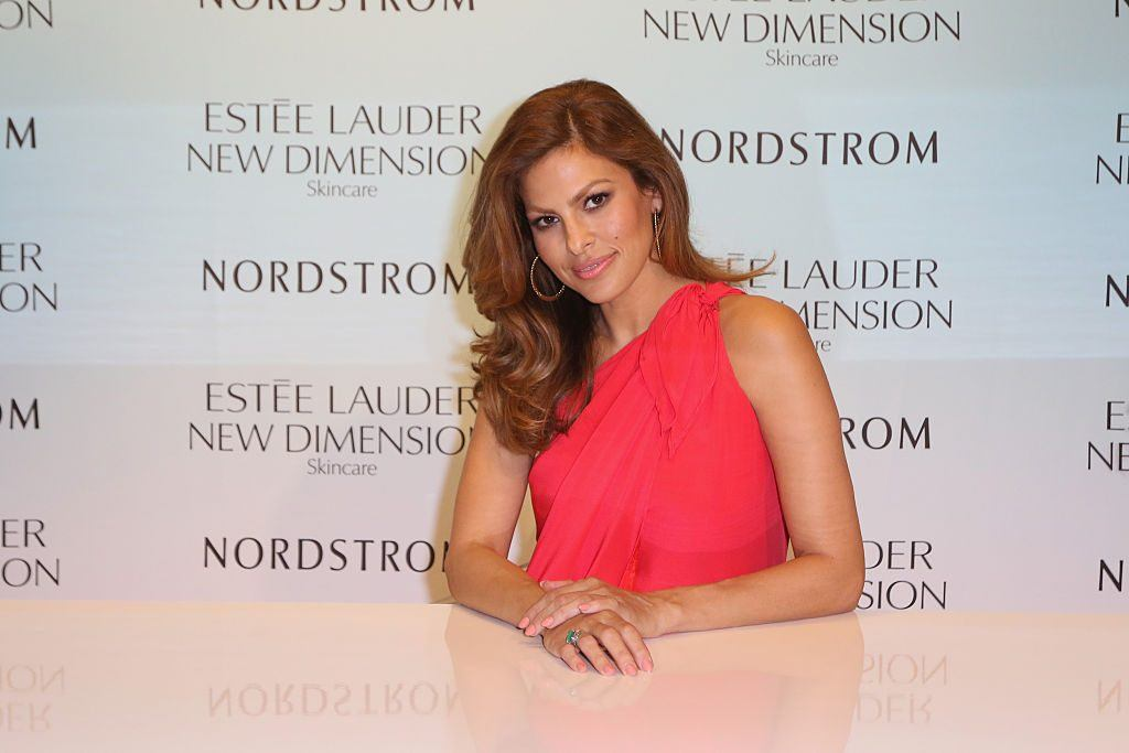 Eva Mendes poses with her hands resting together at an event for Nordstrom