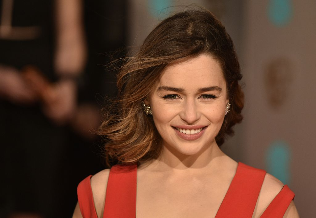 Emilia Clarke poses on arrival for the BAFTA British Academy Film Awards at the Royal Opera House in London on February 14, 2016.