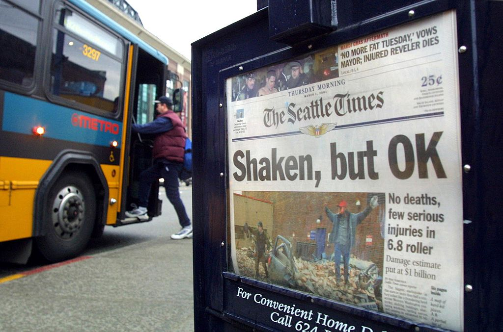 "A 2001 Seattle newspaper headline saying ""shaken, but OK"""