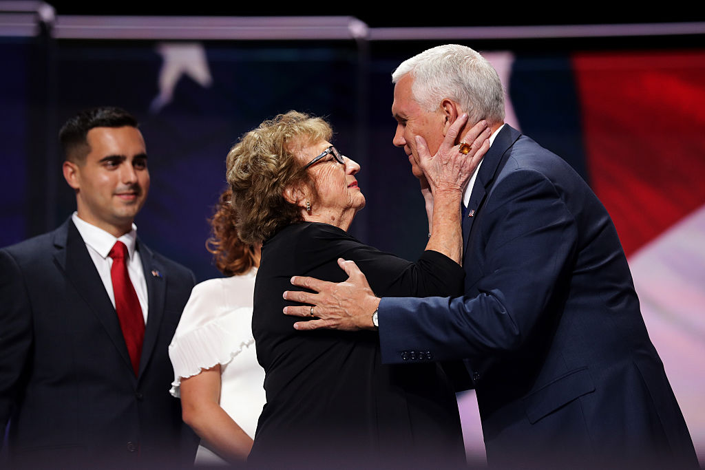 Mike Pence is embraced by his mother, Nancy Pence.