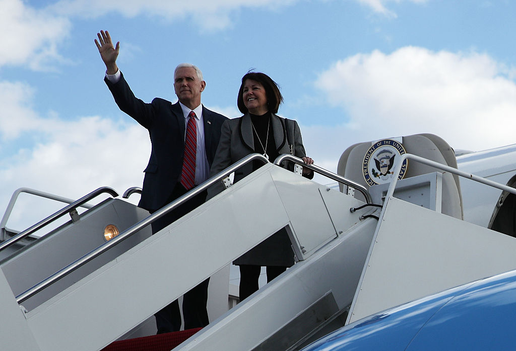 Vice President Mike Pence (L) waves with his wife Karen before they board Air Force Two January 26, 2017 at Joint Base Andrews in Maryland. Vice President Pence is heading to Philadelphia to speak at the Congress of Tomorrow Republican Member Retreat.