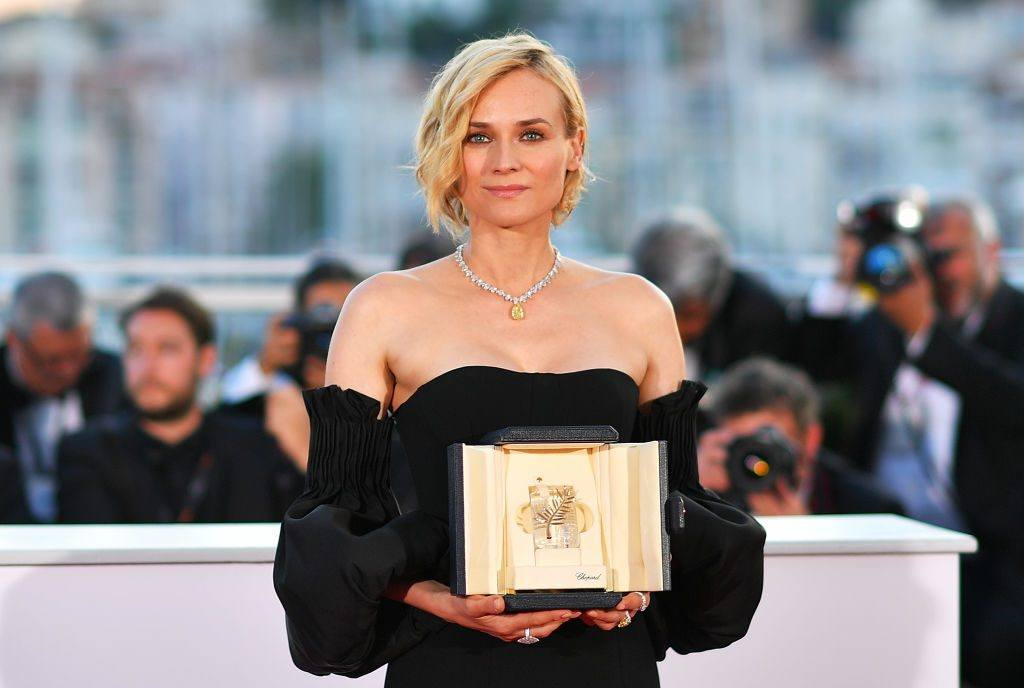 Actress Diane Kruger poses holding her Best Actress prize at Cannes Film Festival in 2017.