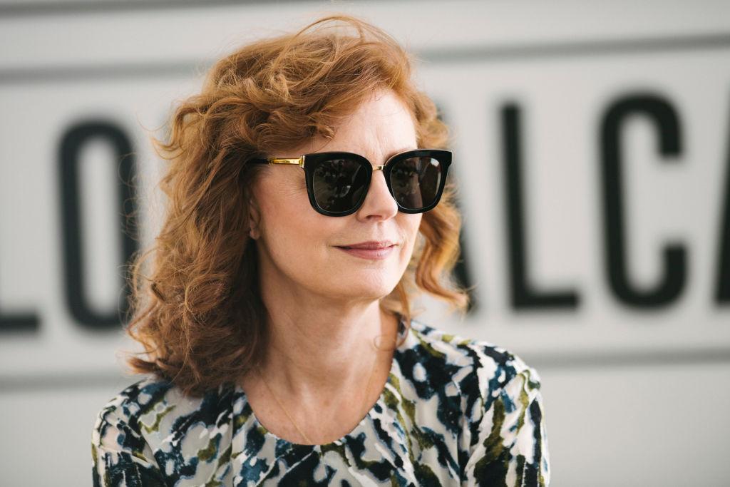 Susan Sarandon smiles in sunglasses