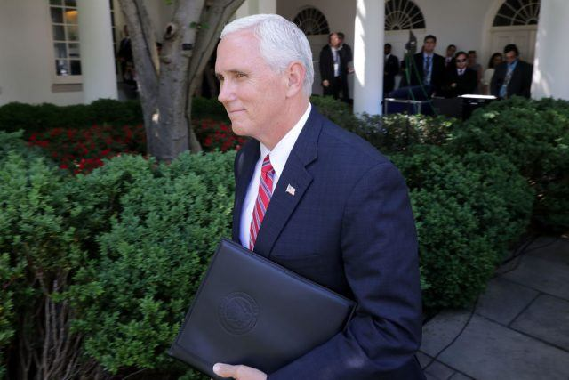 Vice President Mike Pence walks into the Rose Garden.