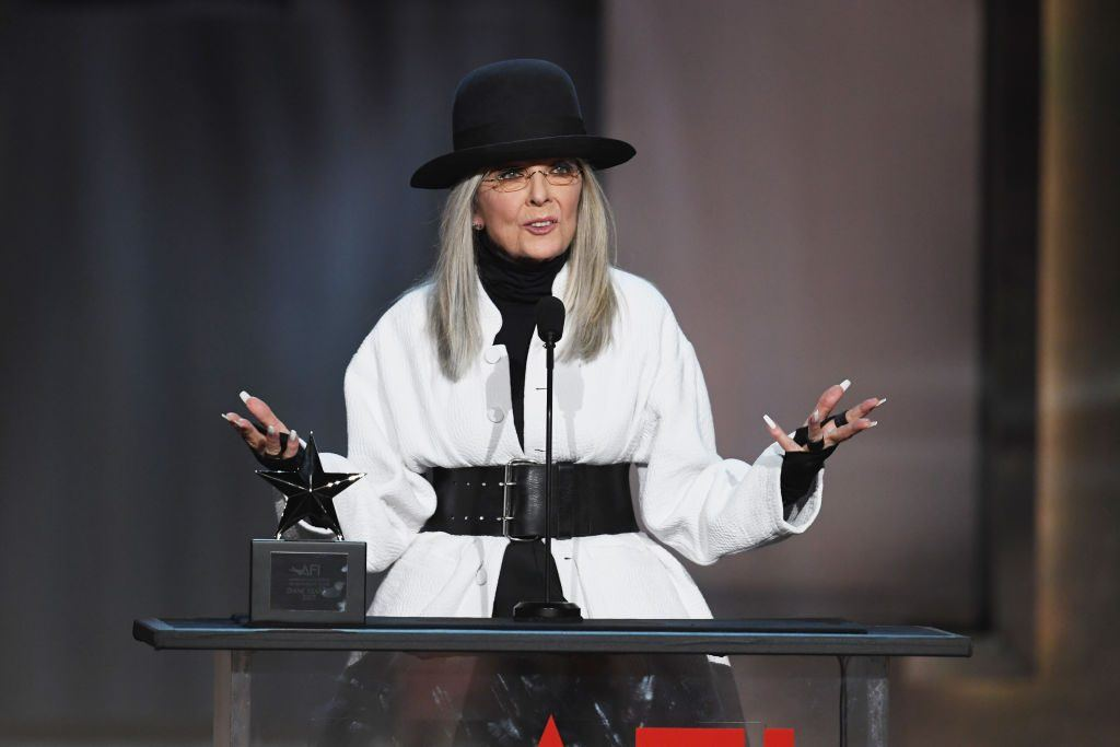 Diane Keaton onstage accepting her AFI Life Achievement Award dressed in black and white