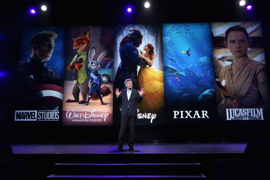 Chairman Alan Horn at Disney's D23 EXPO 2017 standing in front of a screen on images from films.