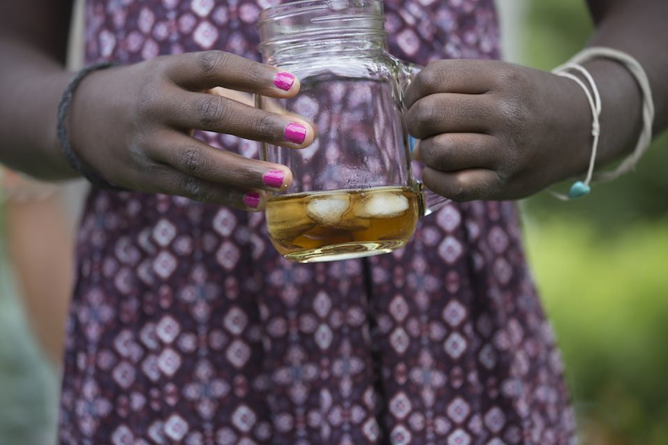 Girl Holding a Cup of Ice Tea