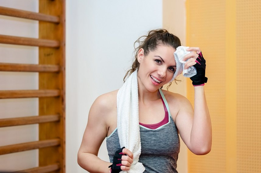 Young women smiling in a exercise room