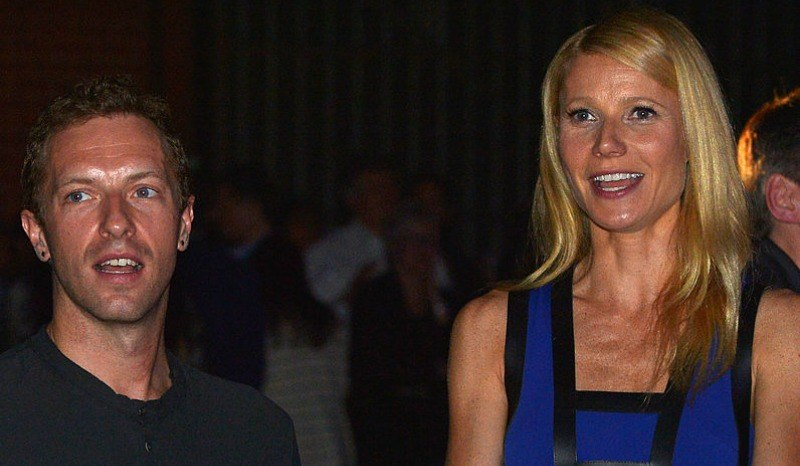 Gwyneth Paltrow and Chris Martin are talking and smiling.