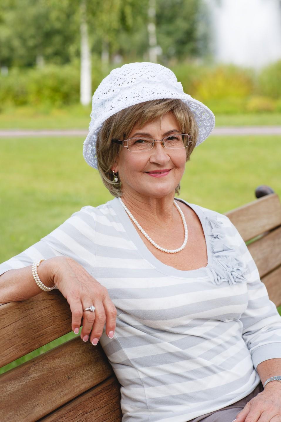 Happy senior woman sitting on a bench