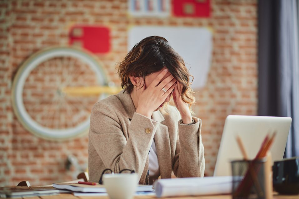woman with headache in office